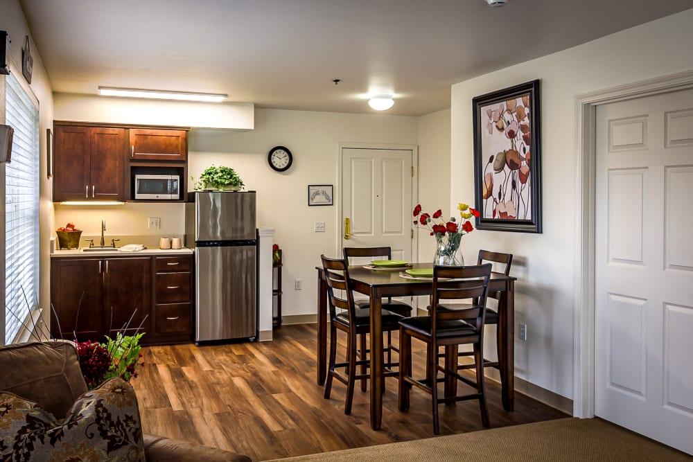 Model dining room and kitchen at Evergreen Senior Living in Eugene, Oregon