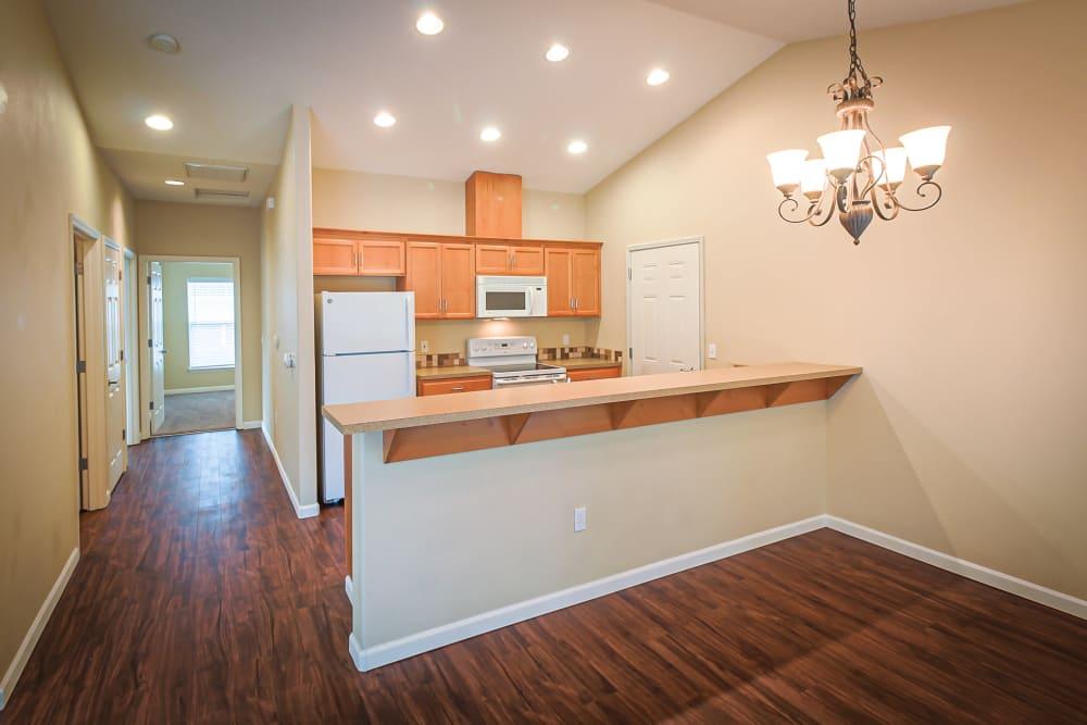 Hardwood flooring in a living room and kitchen at Evergreen Senior Living in Eugene, Oregon