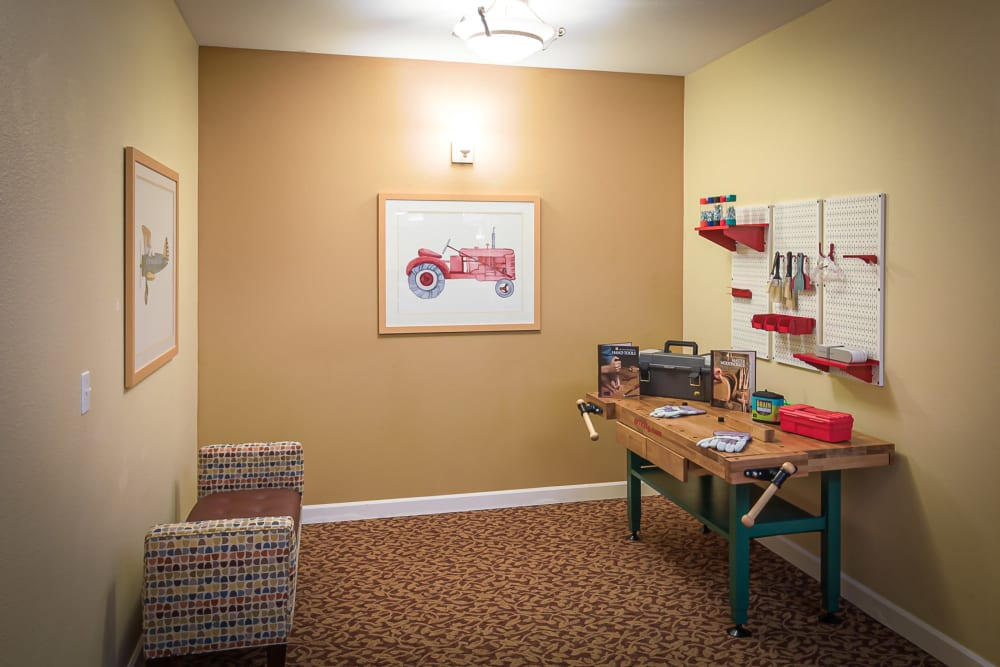 Small room with a work bench and chair at Evergreen Memory Care in Eugene, Oregon