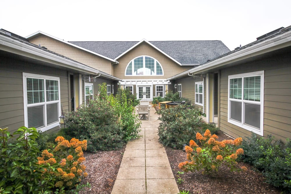 Attractive landscaping with walking paths at Evergreen Memory Care in Eugene, Oregon