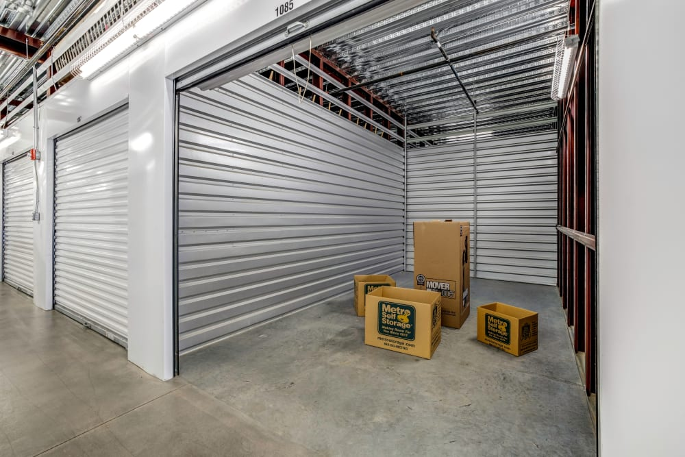 Indoor storage unit with sample boxes inside at Metro Self Storage in Franklin