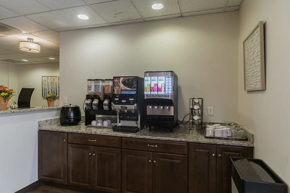Coffee bar with various drink preparation machines at The Hearth on James in Syracuse, New York