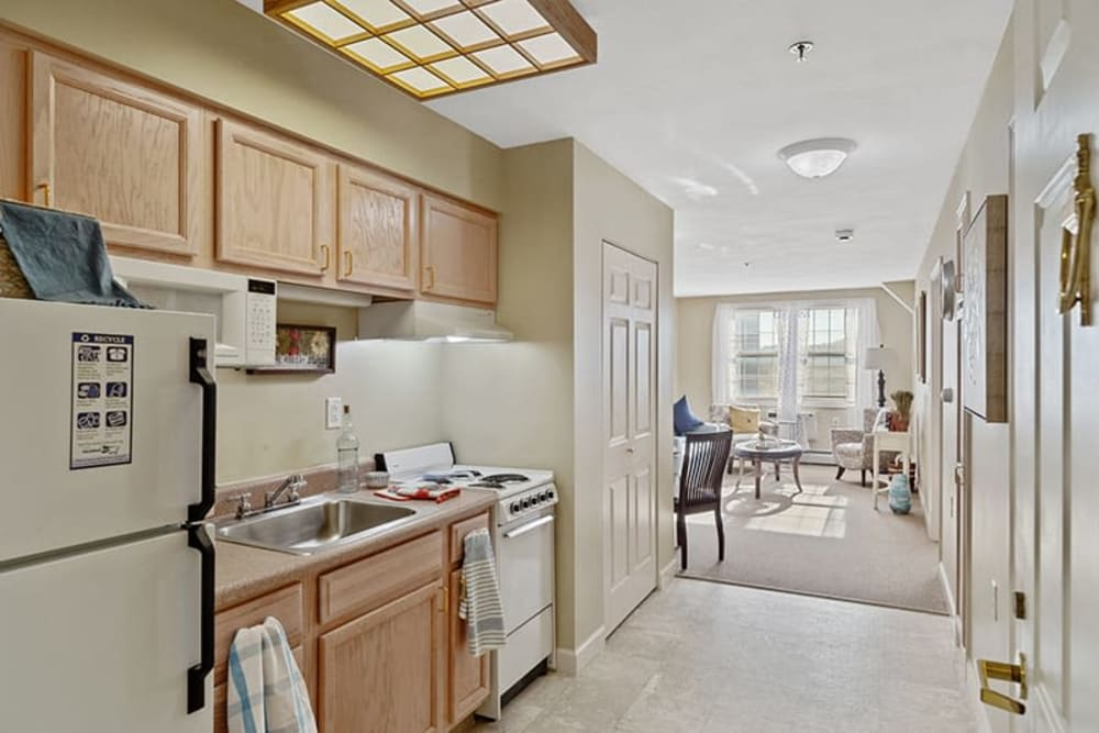 Kitchen by the entryway into an apartment at The Hearth on James in Syracuse, New York