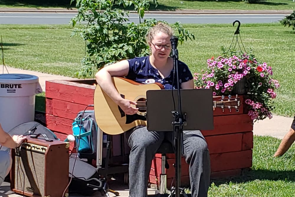 A woman plays the guitar at Landings of Blaine in Blaine, Minnesota