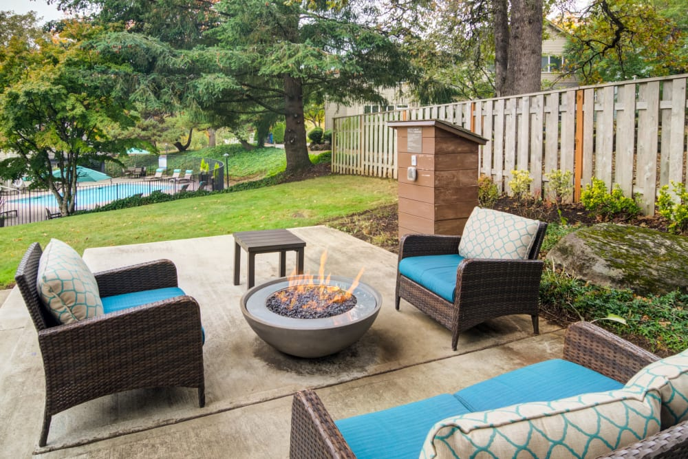 Patio with chairs and a firepit at Sofi Lake Oswego in Lake Oswego, OR
