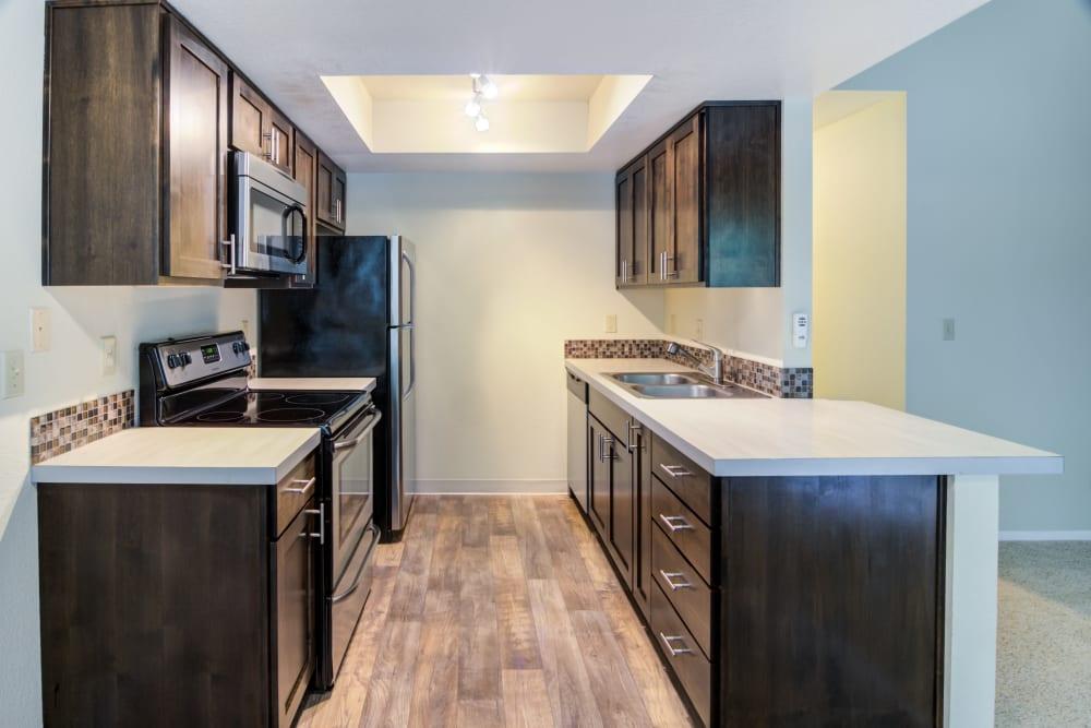 Dark wood kitchen at Sofi Lake Oswego in Lake Oswego, OR