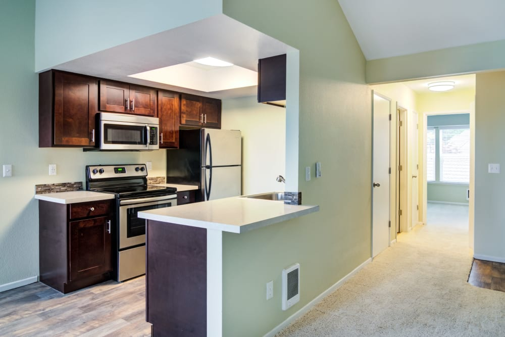 View of the kitchen from the living room at Sofi Lake Oswego in Lake Oswego, OR