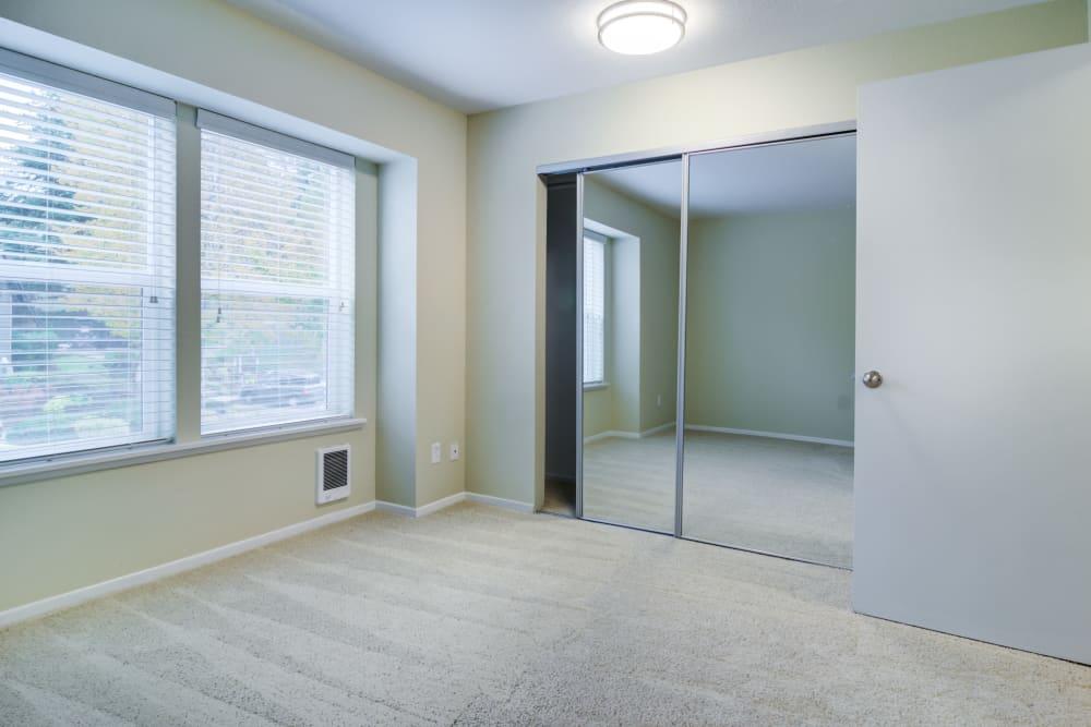 Bedroom with sliding closet doors at Sofi Lake Oswego in Lake Oswego, OR