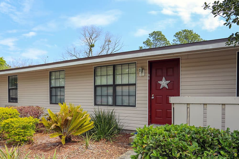 Bright red front doors at Stonewood Apartments in Jacksonville, Florida