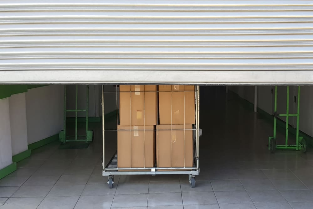 Boxes on a moving cart at Woodlands Self Storage in Tulsa, Oklahoma