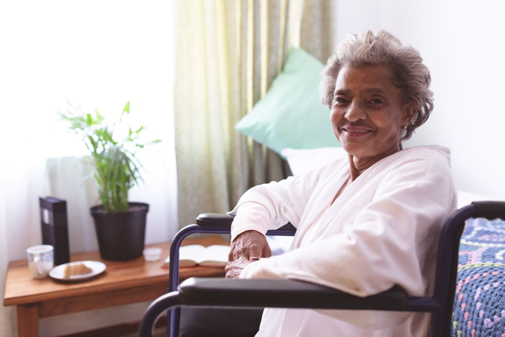 A smiling resident at Inspired Living Delray Beach in Delray Beach, Florida