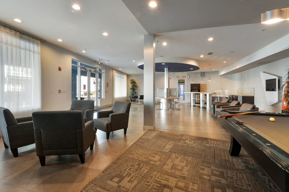 Clubhouse with a game room at Optimist Lofts in Atlanta, Georgia