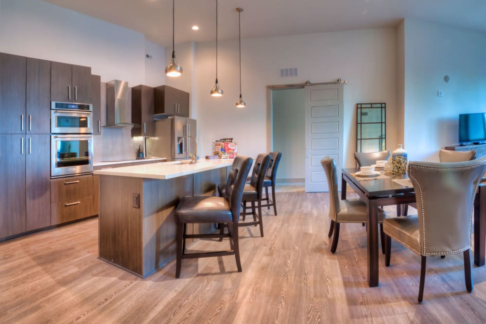 Kitchen with wood-style flooring at Altitude in Atlanta, Georgia