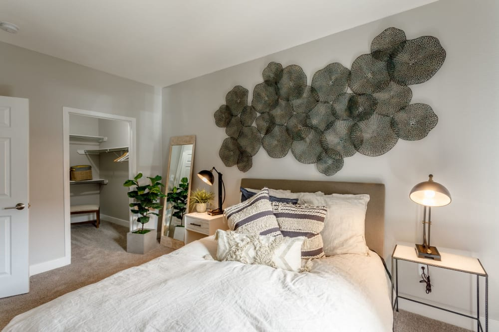 A spacious, decorated master bedroom at Altitude Westminster in Westminster, Colorado
