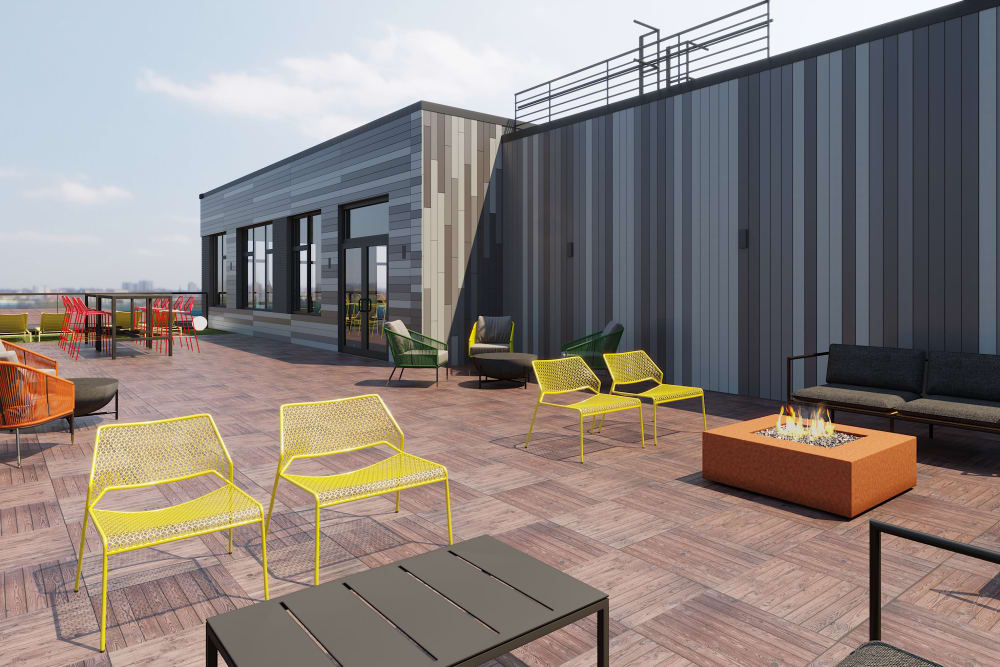Rendering of rooftop with fireplace and ample seating at Arthaus Apartments in Allston, Massachusetts