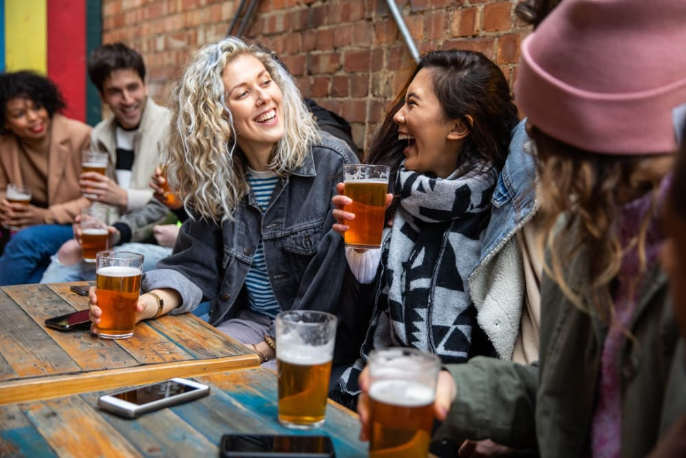 Resident enjoying a beer with friends near Optimist Lofts in Atlanta, Georgia