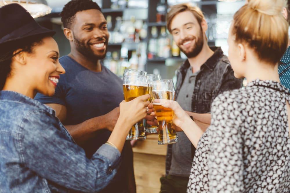 Friends hanging out at a local bar near Optimist Lofts in Atlanta, Georgia
