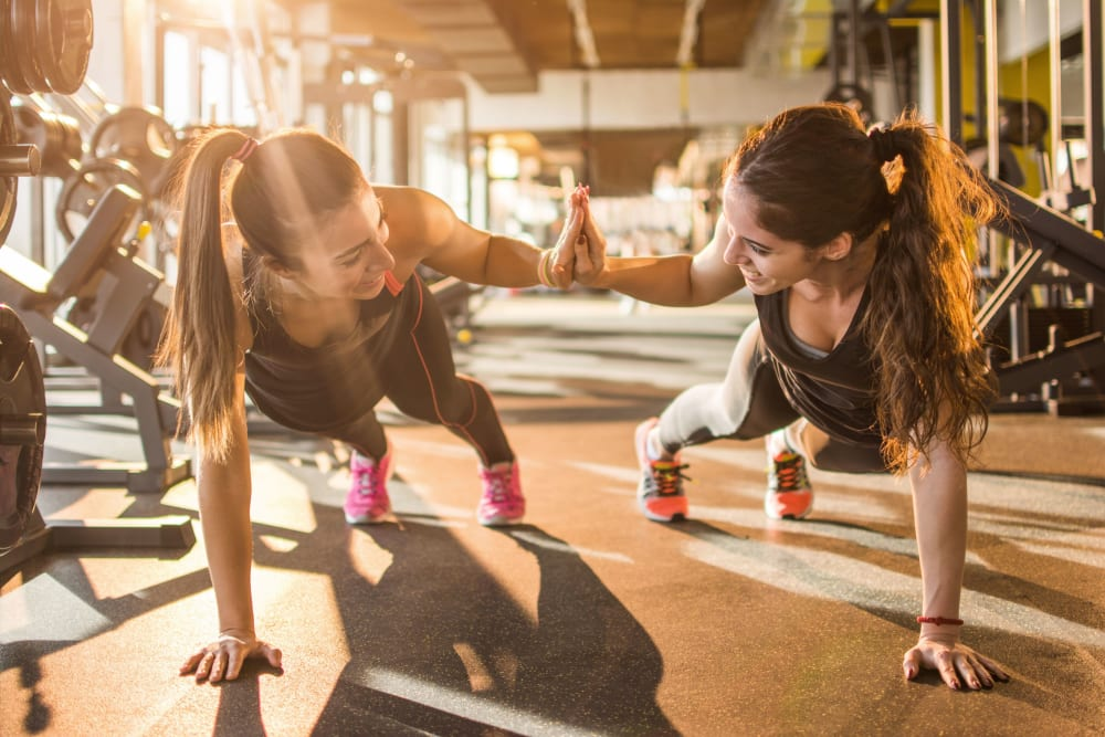 Resident sisters working out in the gym together at Eighteen51 Brinker in Denton, Texas
