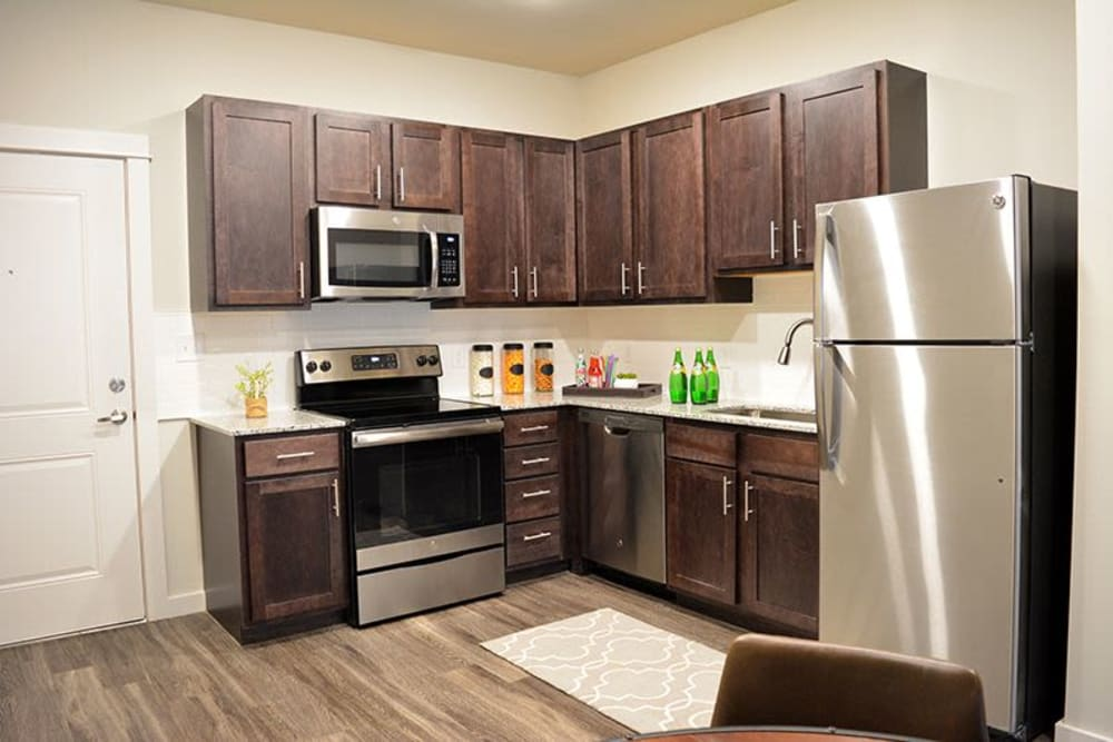 A kitchen with stainless-steel appliances at Pure St. Peters in Saint Peters, Missouri