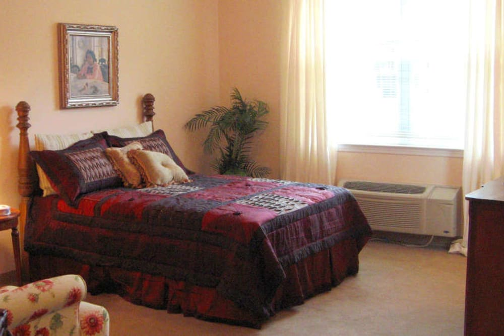 Resident bedroom at Grand Villa of Palm Coast in Palm Coast, Florida.