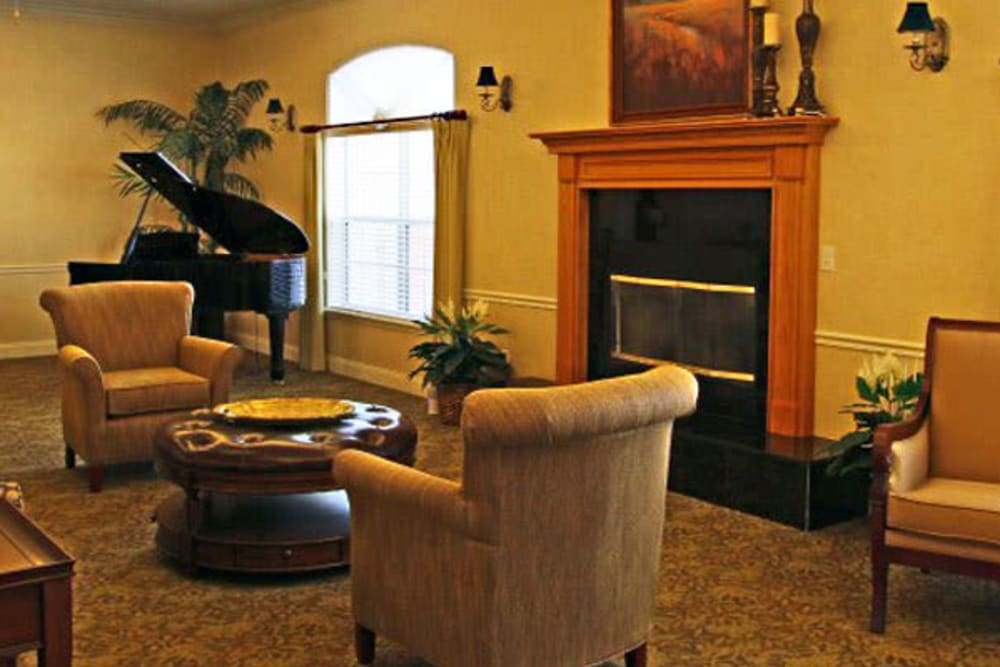 Fireplace seating at Grand Villa of Palm Coast in Palm Coast, Florida