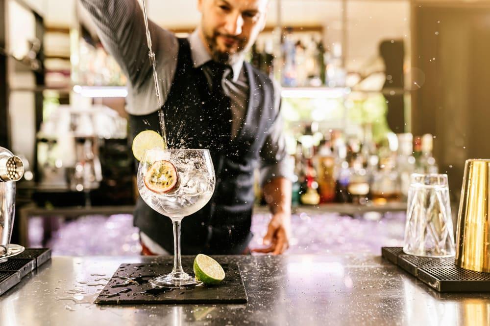 Bartender mixing a cocktail near 511 Meeting in Charleston, South Carolina