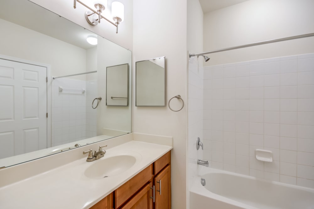 A bathroom with an oval tub at Manassas Station Apartments in Manassas, Virginia