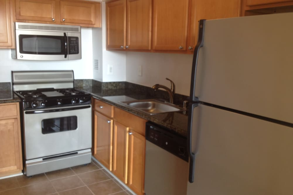 A kitchen with plenty of cabinetry at Westwood Tower Apartments in Bethesda, Maryland