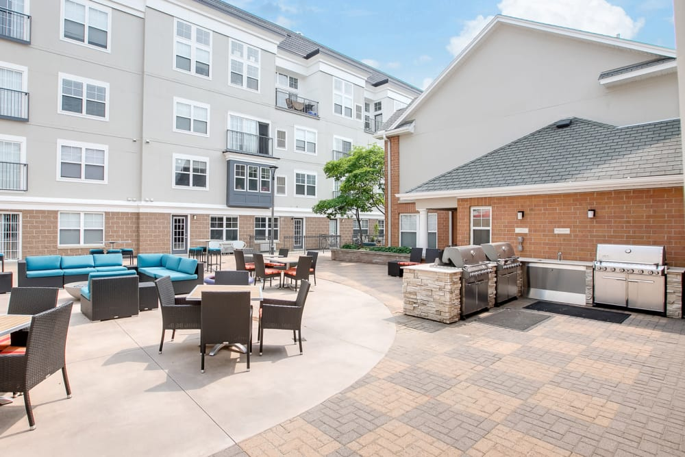 Communal BBQ area in courtyard at Loring Park Apartments in Minneapolis, Minnesota