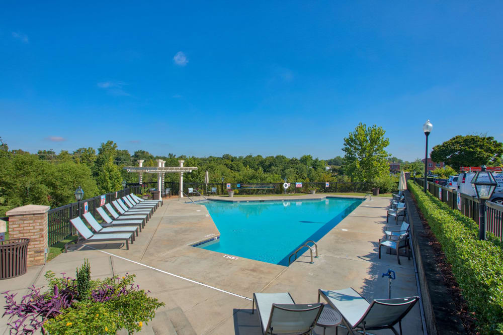 Pool with lots of seats for residents and friends at Atkins Circle Apartments & Townhomes in Charlotte, North Carolina