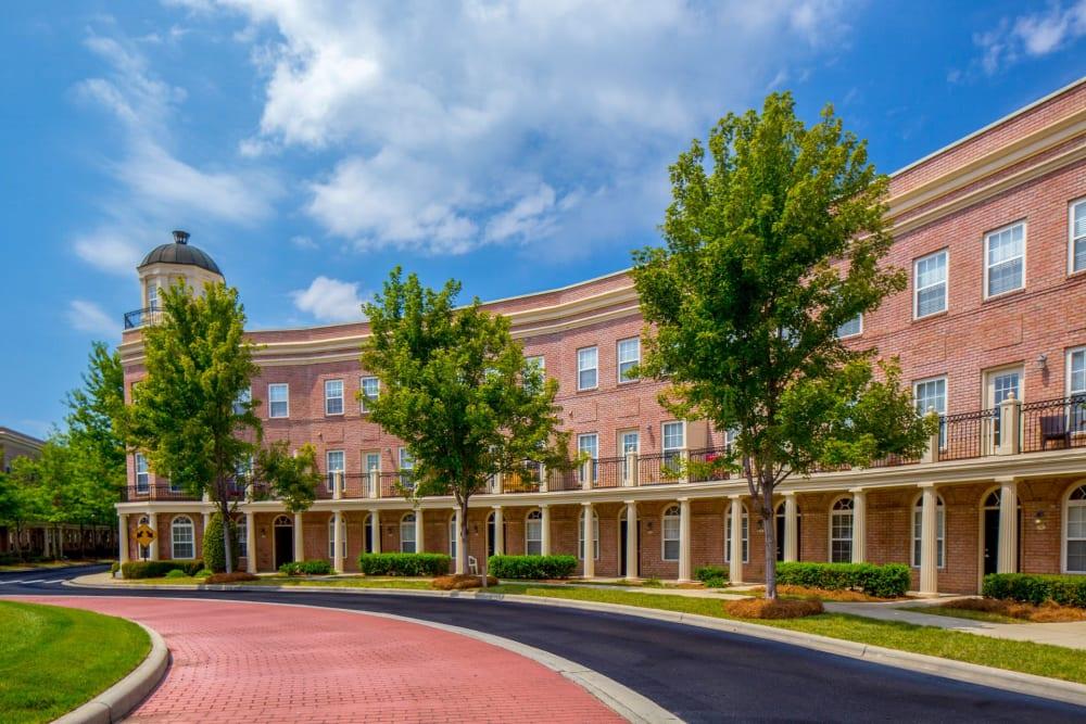 Brick sidewalk in front of the brick buildings at Atkins Circle Apartments & Townhomes Apartments in Charlotte, North Carolina