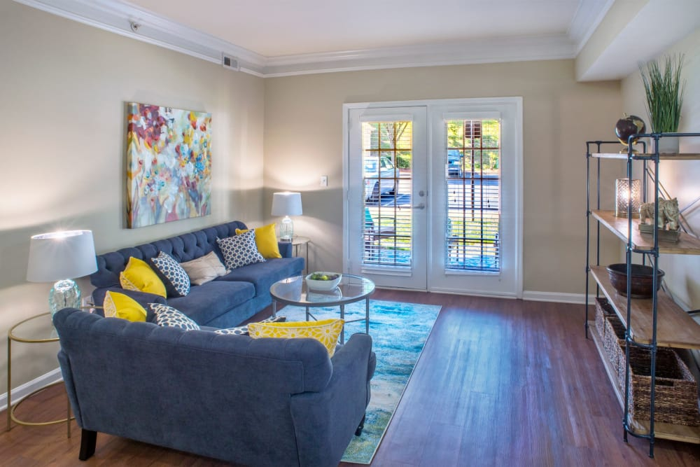 Living room staged nicely with wood style floors at Atkins Circle Apartments & Townhomes in Charlotte, North Carolina