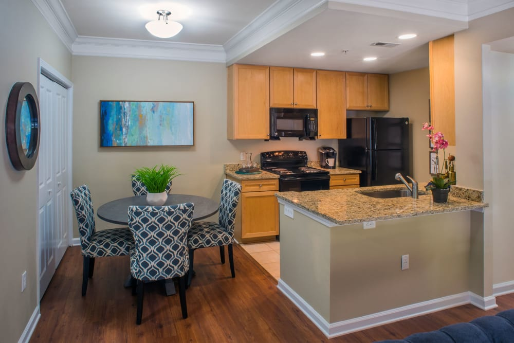 Dining area and breakfast bar at Atkins Circle Apartments & Townhomes in Charlotte, North Carolina