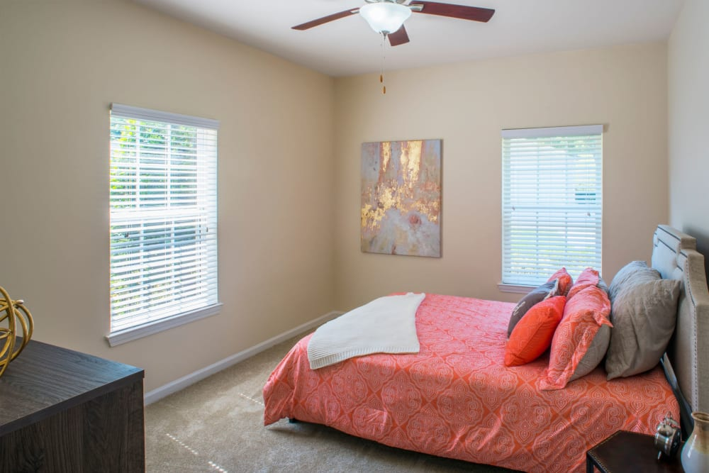 Bedroom with lots of natural light and ceiling fan at Atkins Circle Apartments & Townhomes in Charlotte, North Carolina