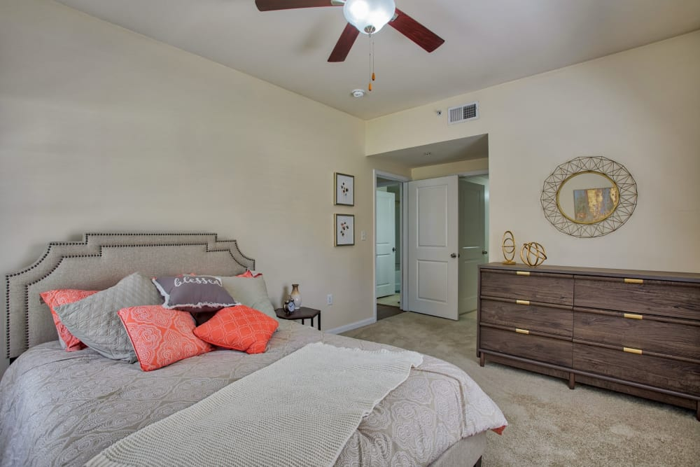 Bedroom with ceiling fan in Atkins Circle Apartments & Townhomes in Charlotte, North Carolina