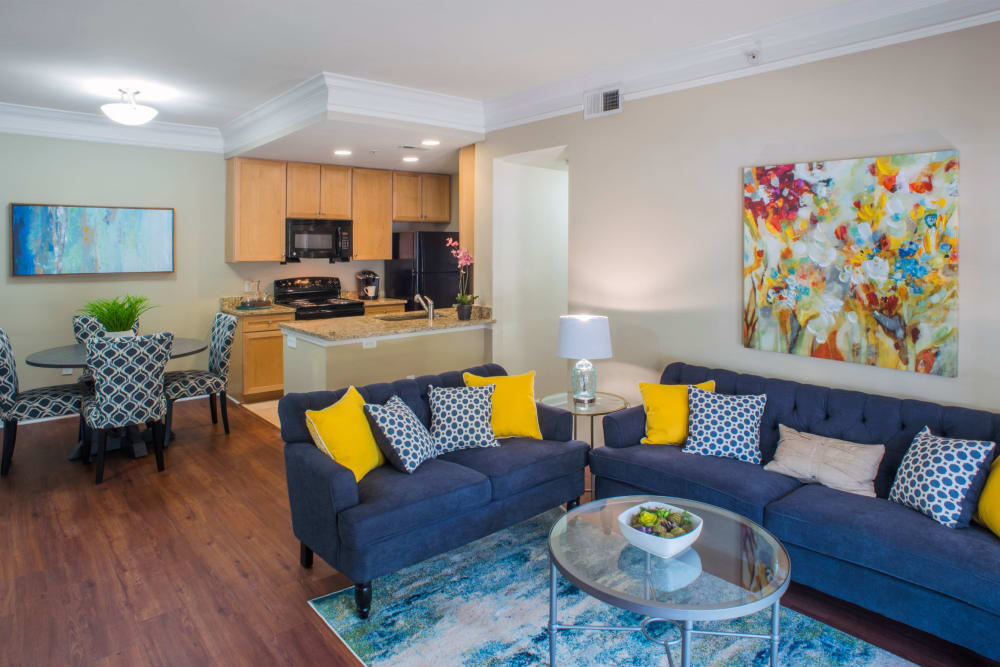Spacious living room with couch and coffee table at Atkins Circle Apartments & Townhomes in Charlotte, North Carolina