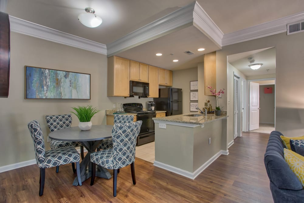 Dining area and breakfast bar next to kitchen at Atkins Circle Apartments & Townhomes in Charlotte, North Carolina