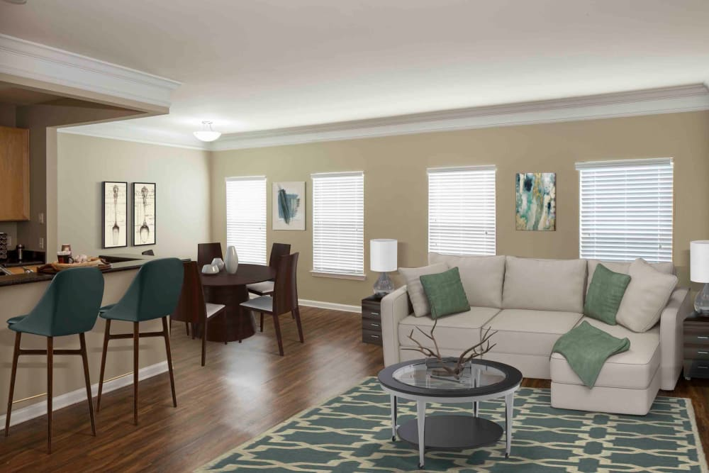 Sitting area in living room next to breakfast bar at Atkins Circle Apartments & Townhomes in Charlotte, North Carolina