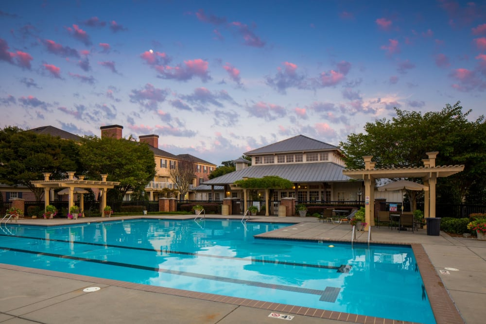 Large swimming pool with club house at Atkins Circle Apartments & Townhomes in Charlotte, North Carolina