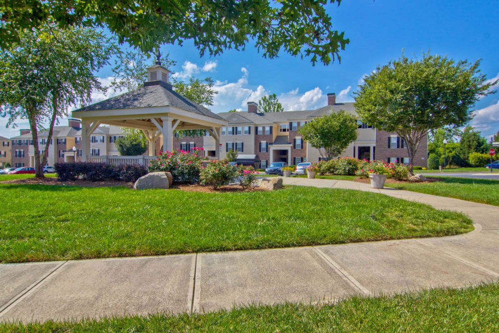 Walking path outside of Atkins Circle Apartments & Townhomes with large gazebo in Charlotte,  North Carolina