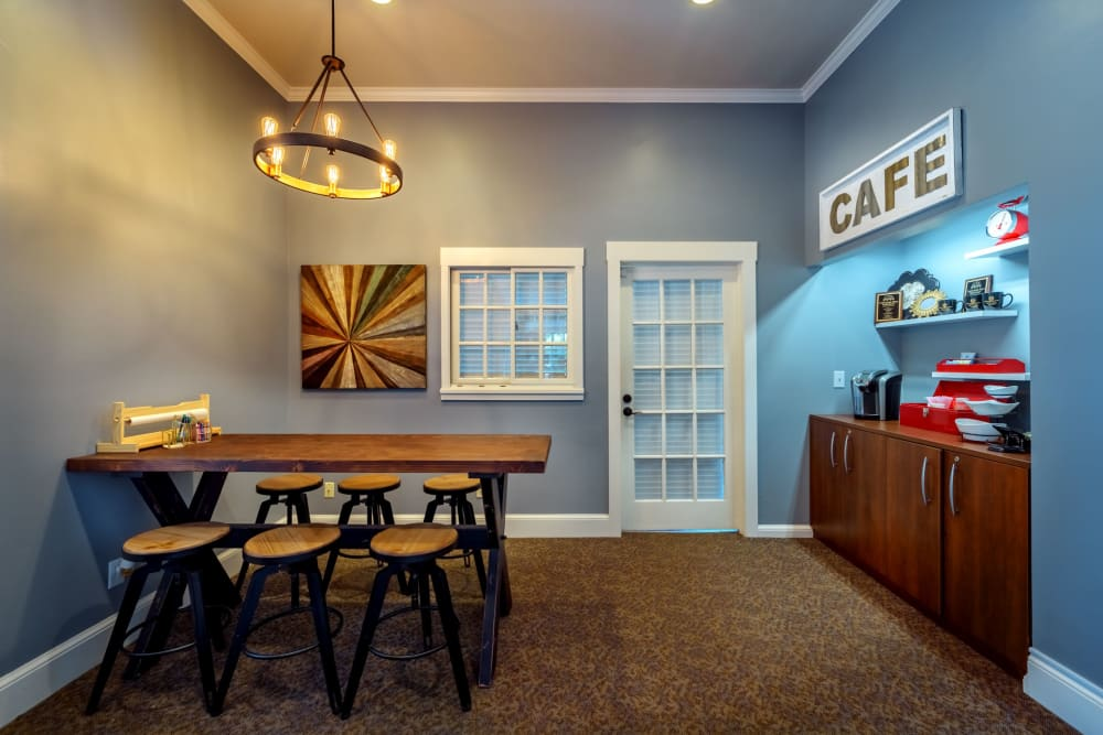 Inside pool clubhouse where there is a table and coffee at Christopher Wren Apartments & Townhomes in Wexford, Pennsylvania