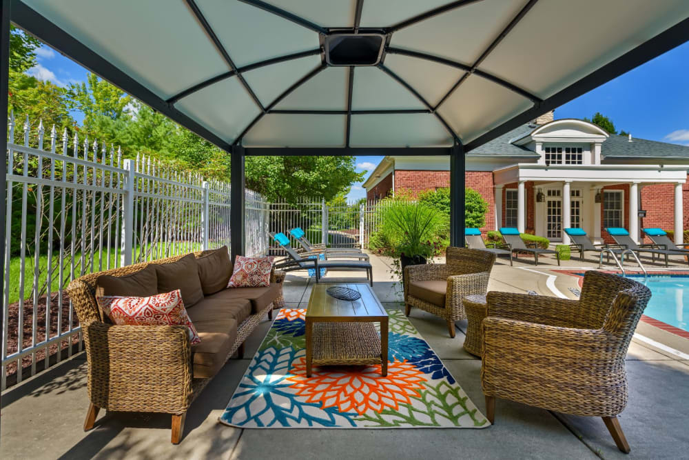 Cabana next to pool with seating underneath at Christopher Wren Apartments & Townhomes in Wexford, Pennsylvania