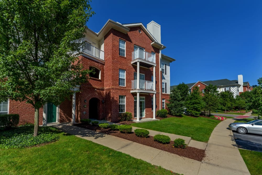 Entrance to Christopher Wren Apartments & Townhomes Apartments with lawn and nice gardening in Wexford, Pennsylvania