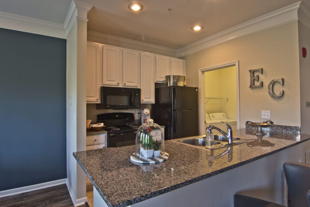 Granite style counter tops in kitchen at Easton Commons Apartments & Townhomes in Columbus, Ohio
