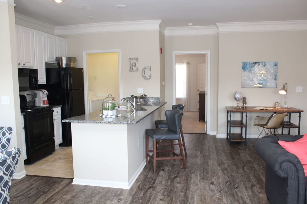 Kitchen and living room with breakfast bar at Easton Commons Apartments & Townhomes in Columbus, Ohio