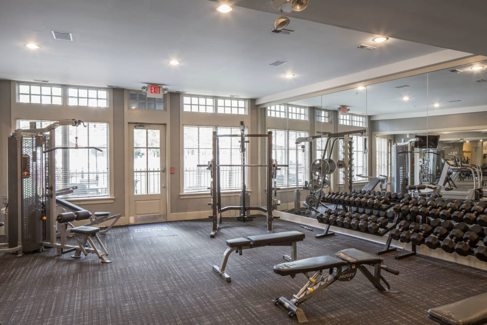 Gym weight lifting area at Easton Commons Apartments & Townhomes in Columbus, Ohio
