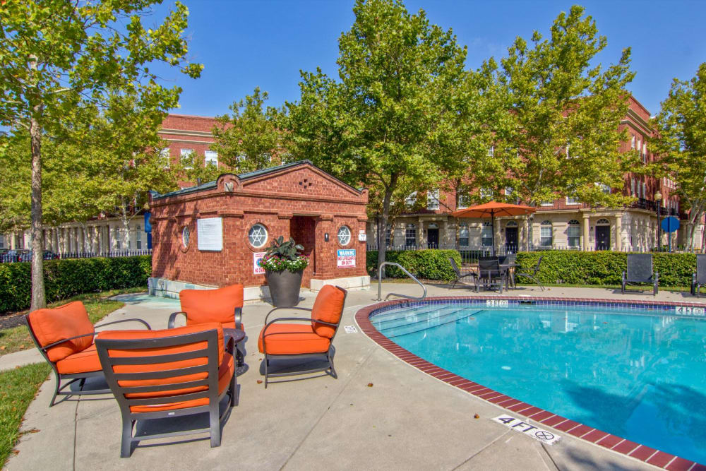 Poolside chairs at Easton Commons Apartments & Townhomes in Columbus, Ohio