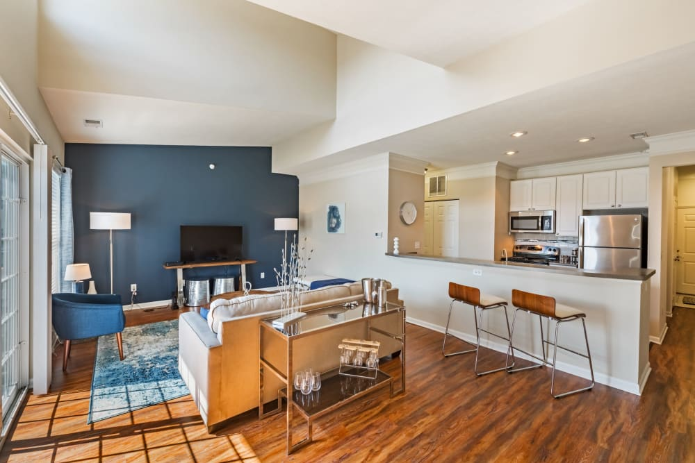 Living room and kitchen area at The Docks Apartments & Townhomes in Pittsburgh, Pennsylvania