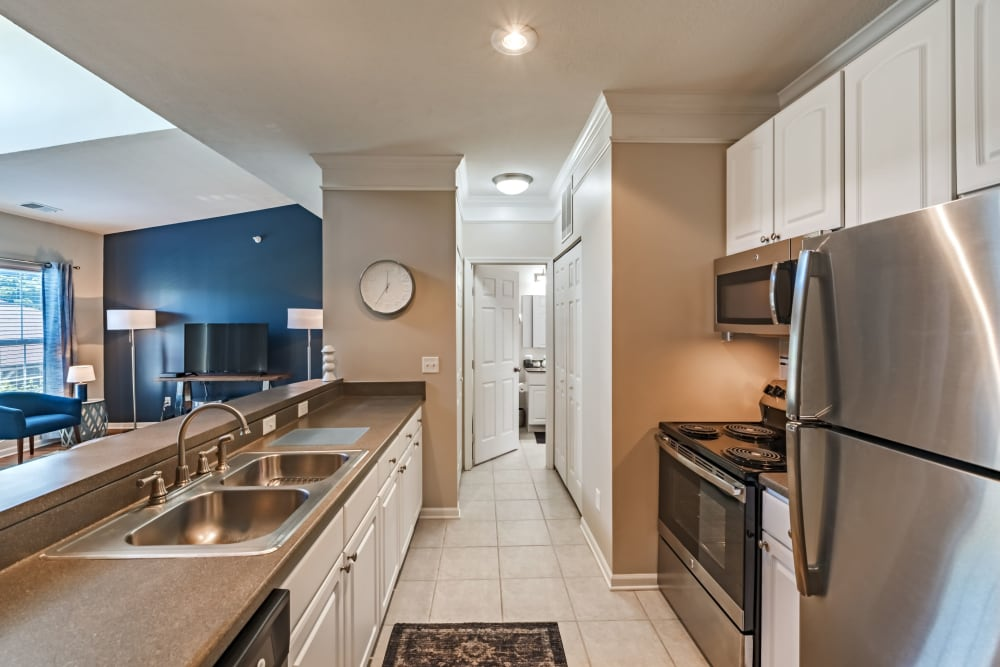 Modern kitchen with stainless steel appliances at The Docks Apartments & Townhomes in Pittsburgh, Pennsylvania