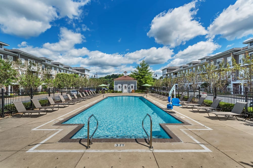 Large pool with ample seating around it at The Docks Apartments & Townhomes in Pittsburgh, Pennsylvania